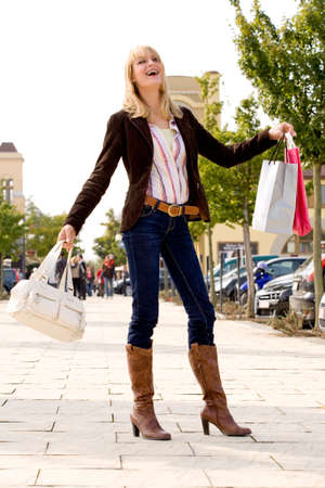 Beauty young girl shopping in the sunny weather photo