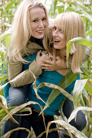 two sisters in a park having fun photo
