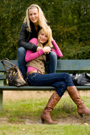 two sisters in a park having fun Stock Photo - 3688266
