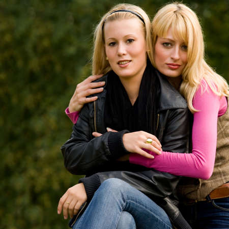 two sisters in a park having fun
