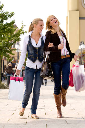 Two young girls shopping in the sunny weather Stock Photo - 3688200