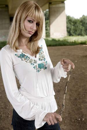 lookalike: Bored Paris Hilton look-a-like in a fashion shoot