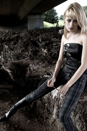 lookalike: Fashion shoot of Paris Hilton look-a-like between dead trees