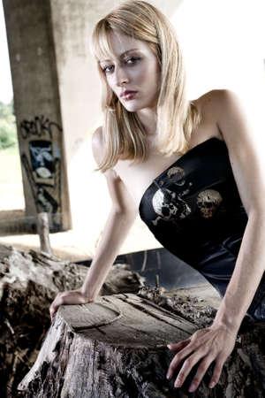 lookalike: Fashion shoot of Paris Hilton look-a-like on a tree stump Stock Photo