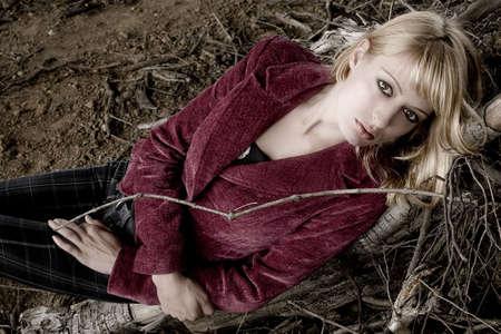 lookalike: Fashion shoot of Paris Hilton look-a-like in dead wood Stock Photo
