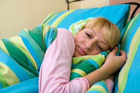 Blond model who looks like Paris Hilton waking up in payamas Stock Photo