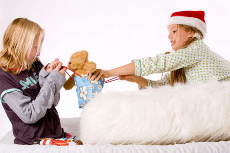 Two children having a fight about the present Stock Photo - 3758431