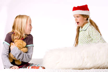 Two children having a fight about the present photo