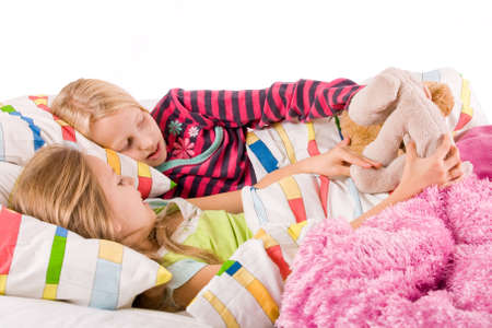 Two young children enjoying their colorful bed Stock Photo - 3766973