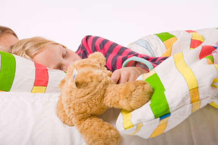 Two young children enjoying their colorful bed Stock Photo - 3760653