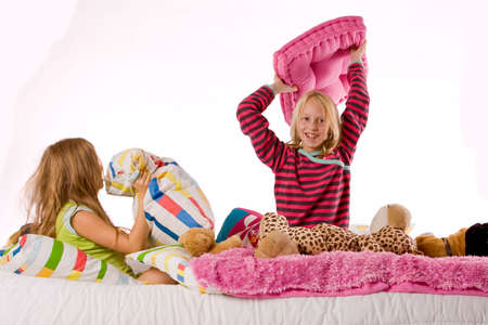 Two young children enjoying their colorful bed Stock Photo - 3760642
