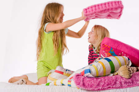 Two young children enjoying their colorful bed Stock Photo - 3766988