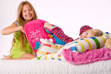 Two young children enjoying their colorful bed Stock Photo - 3766979