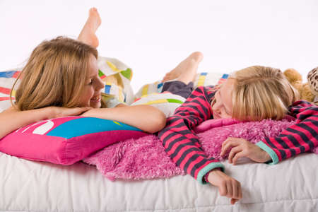 Two young children enjoying their colorful bed Stock Photo - 3767007