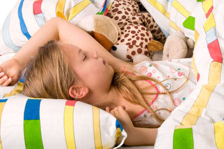 sleep well: Sleeping young cute child in a colorful bed