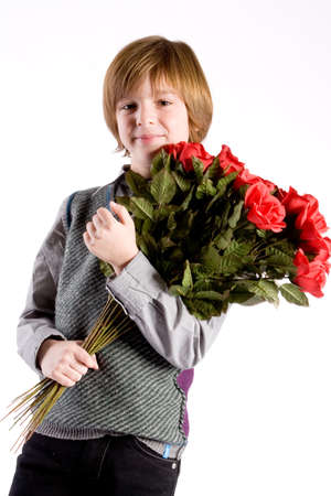 Sweet valentine boy with a lot of red roses