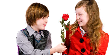 Young children couple with a red rose Stock Photo - 3997325