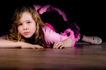 talented: Young talented ballet girl on the floor Stock Photo