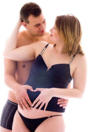 pregnant lingerie: A young couple expecting their little wonder Stock Photo