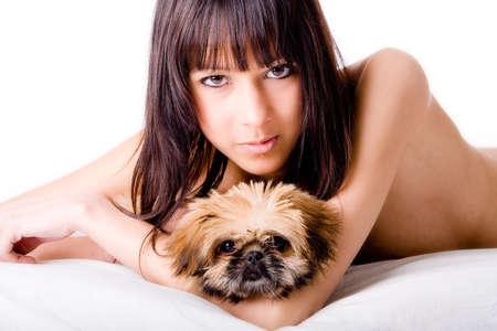 Brunette woman with a cute little pekingese photo