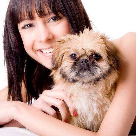 Brunette woman with a cute little pekingese Stock Photo