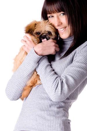 Brunette woman with a cute little pekingese Stock Photo