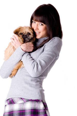 pekingese: Brunette woman with a cute little pekingese Stock Photo