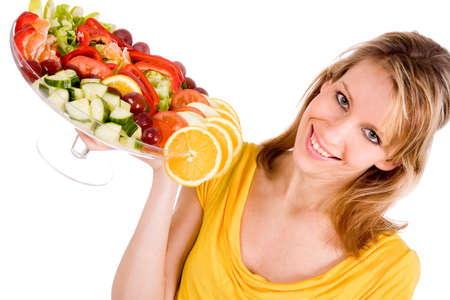 Young girl is presenting a delicous salad photo
