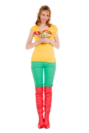 Young girl is posing with a delicious salad photo