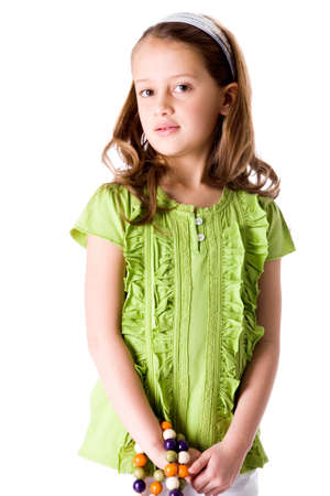 Young brunette child posing in different clothes photo