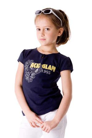 Young brunette Kind stellt in verschiedenen Kleider Standard-Bild - 4338112