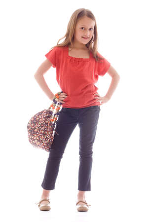 Young brunette child posing in different clothes Stock Photo