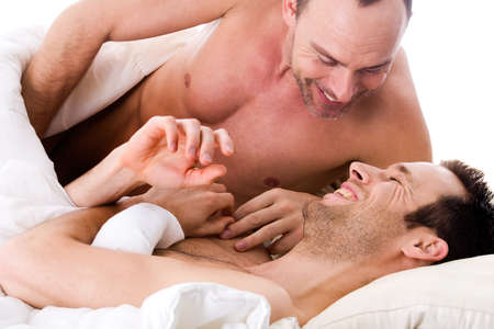 nude in bed: Happy homo couple in a white bed taking care of his boyfriend