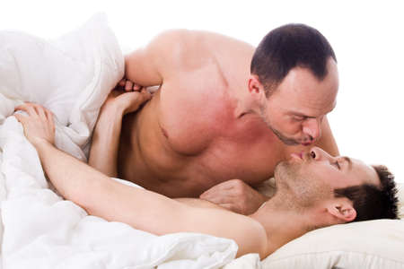 Happy homo couple in a white bed taking care of his boyfriend