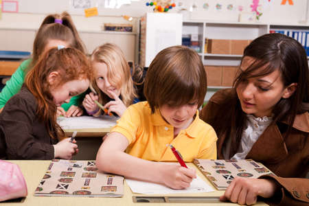 Group of little students with different ages in a classroom Stock Photo - 4496860