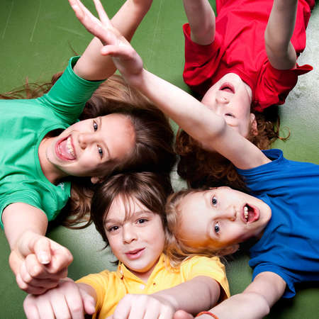 Group of little students with different ages in a happy mood  Stock Photo