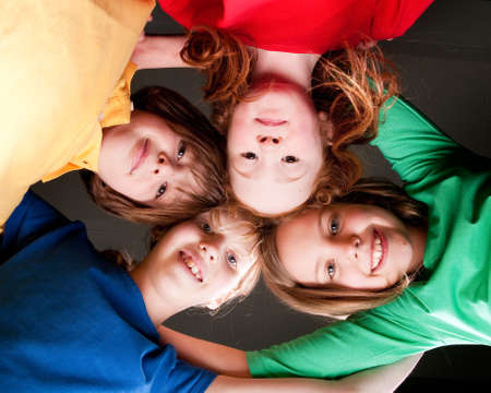 Group of little students with different ages in a happy mood photo