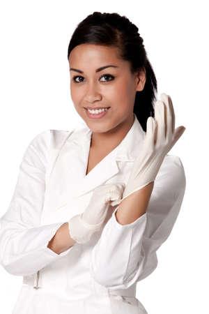 guanti infermiera: Beautifull indonesiano infermiere in bianco uniforme Archivio Fotografico