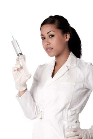 gloves nurse: Beautifull Indonesian nurse in white uniform