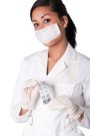 Beautifull Indonesian nurse in white uniform photo