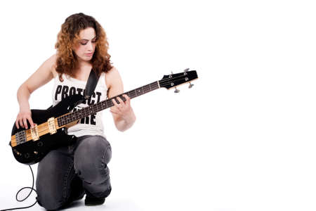 hardrock: Young female bass guitar player specially isolated on white