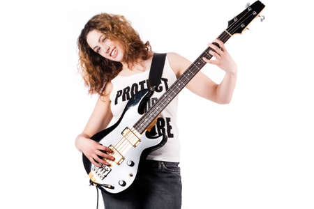 Young female bass guitar player specially isolated on white photo