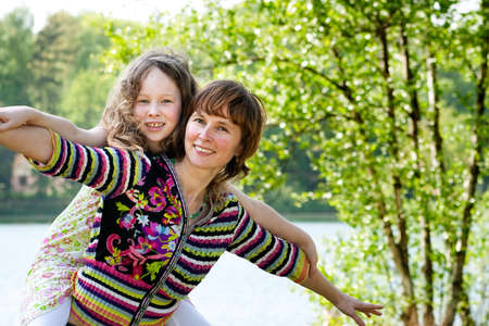 Mother and daughter have a happy time together photo