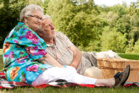 Elderly couple enjoying the spring in the park