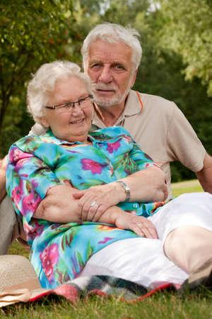 Elderly couple enjoying the spring in the park Stock Photo - 5217131