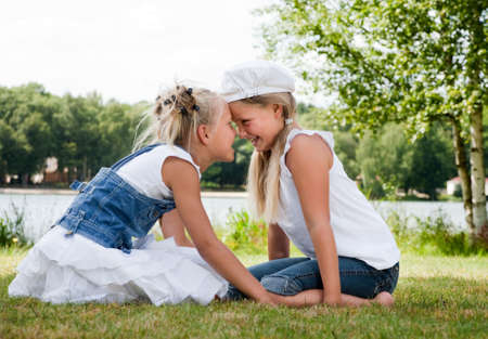 Two little girls in fresh colors in the park photo