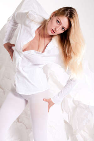 Beautiful blond young woman in sexy white posing high fashion style Stock Photo - 5259669
