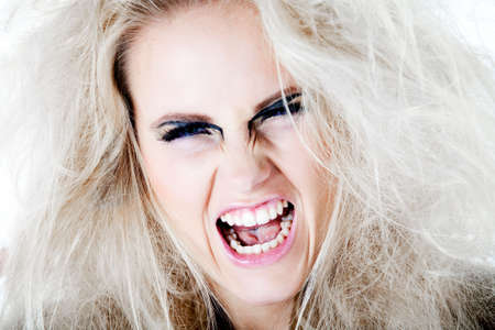 Screaming model with white wild hair. Usable for health and beauty, cosmetics, love, hate and emotional issues. photo