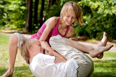 tickling: Happy family enjoying their free time in the park
