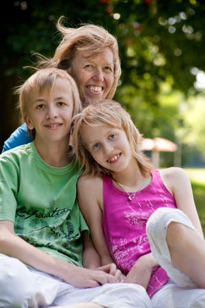 Happy family enjoying their free time in the park Stock Photo - 5353743